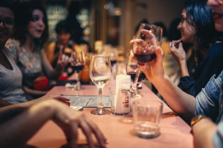 people drinking liquor and talking on dining table close up 696218 450x300 - 11 Smart Ways to Save Money
