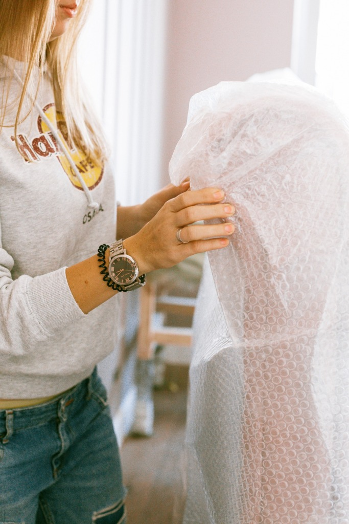 woman holding a bubble wrap 3616730 1 683x1024 - Five Tips for When You're Moving a House