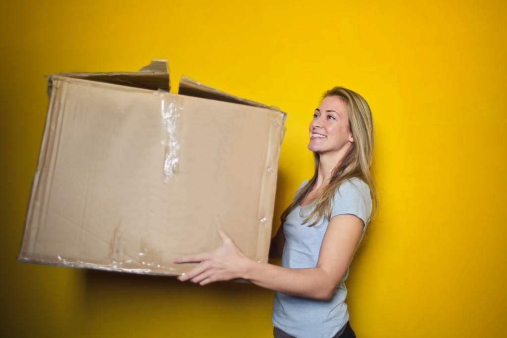 woman in grey shirt holding brown cardboard box 761999 1024x683 - Five Tips for When You're Moving a House