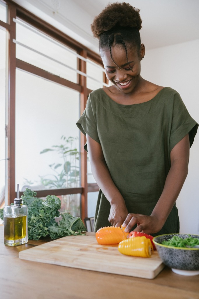 woman in green tank top holding orange bell pepper 3622643 683x1024 - The Coronavirus Positivity Post: What's Keeping You Smiling Though The Pandemic?