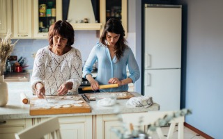 women making dumplings in the kitchen 3893527 320x200 - The Coronavirus Positivity Post: What's Keeping You Smiling Though The Pandemic?