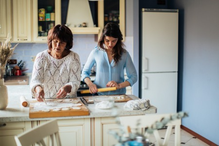 women making dumplings in the kitchen 3893527 450x300 - The Coronavirus Positivity Post: What's Keeping You Smiling Though The Pandemic?
