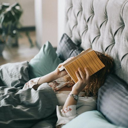 woman covering face with book on bed 1524232 435x435 - Is Your Bedroom Set Up For Sleeping?