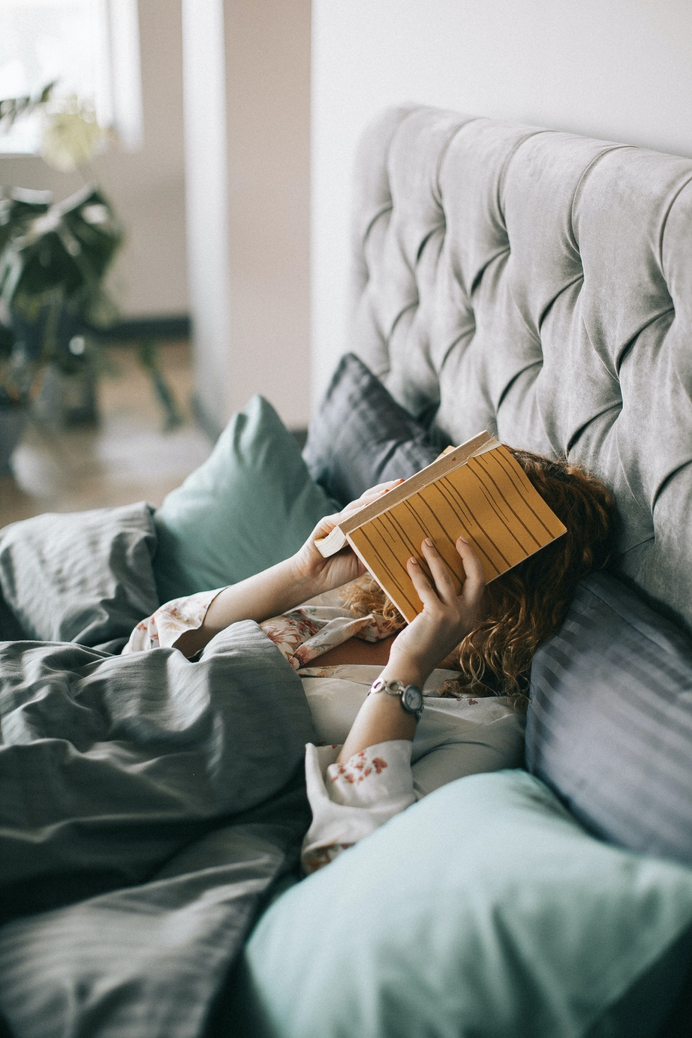 woman covering face with book on bed 1524232 - Is Your Bedroom Set Up For Sleeping?